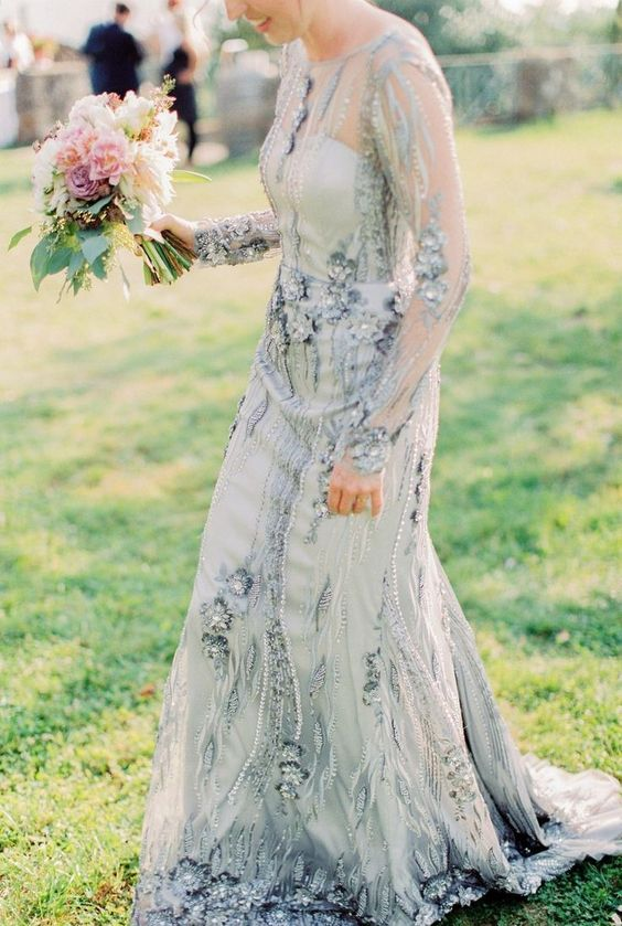 a blue embellished wedding dress with sheer long sleeves and an illusion neckline