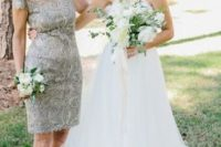 03 a bold grey lace sheath dress with cap sleeves and an illusion neckline plus matching shoes