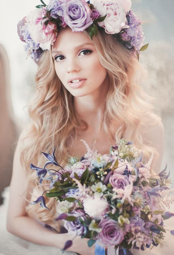 a large romantic floral crown in the shades of lilac and pink plus a matching bouquet for a spring bride