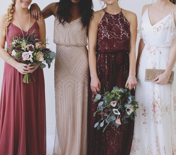 mismatched bridesmaids' dresses in blush and burgundy for a fall wedding