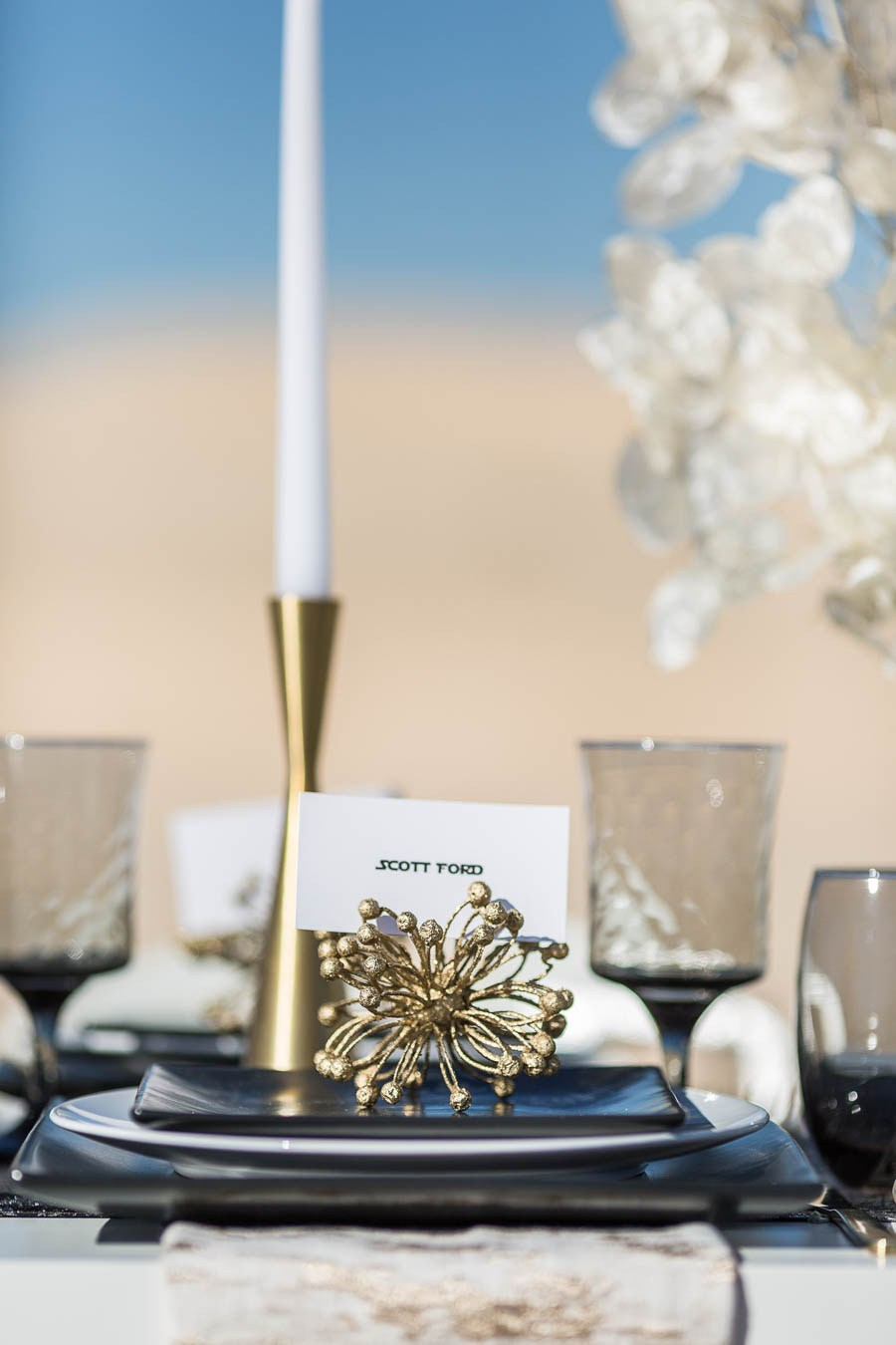 The table featured black plates, glasses and lots of gold touches for a chic feel