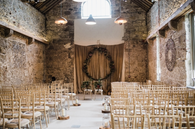 The wedding ceremony took place here, in an ancient barn, the wreath was made by the groom