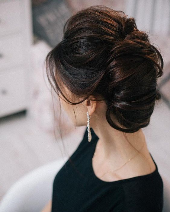 a large French twist chignon with a bump and messy touches for a breathtaking look