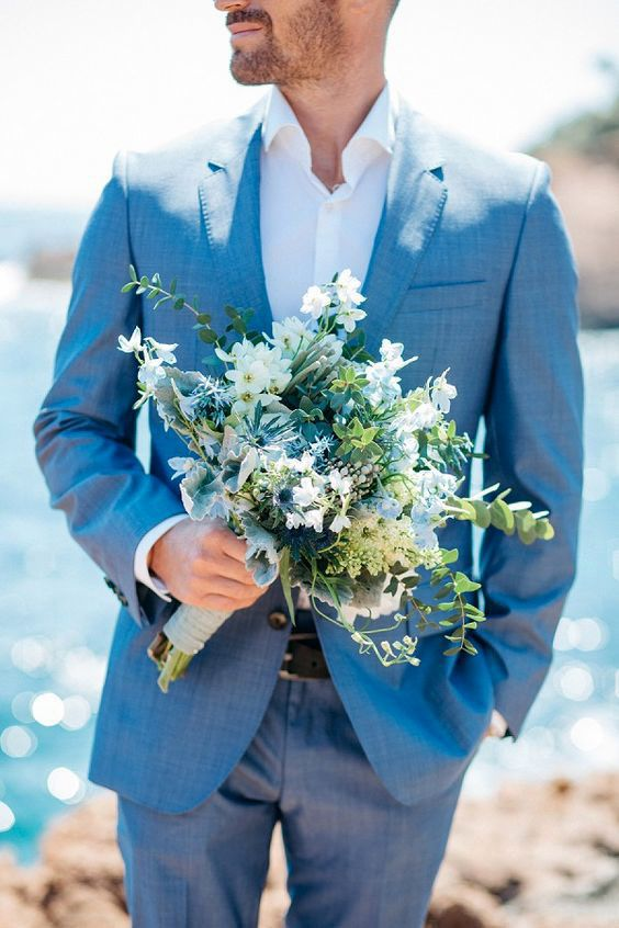 a light blue suit, a white shirt and no tie for a relaxed coastal groom look