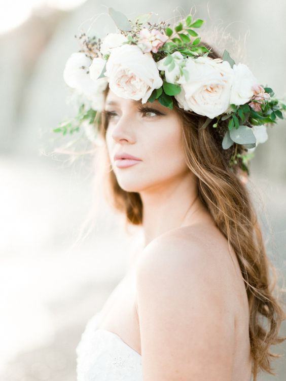 a neutral large floral crown with blush peonies and blooms plus berries and greenery for a romantic bride