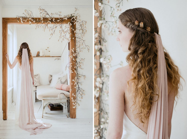 Her veil was a blush long one and there was a peculiar hairpiece, the half updo with waves down looked very romantic