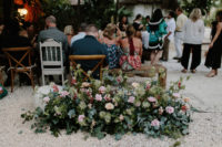 05 Lush florals with pink roses and much greenery were created for every space of the wedding