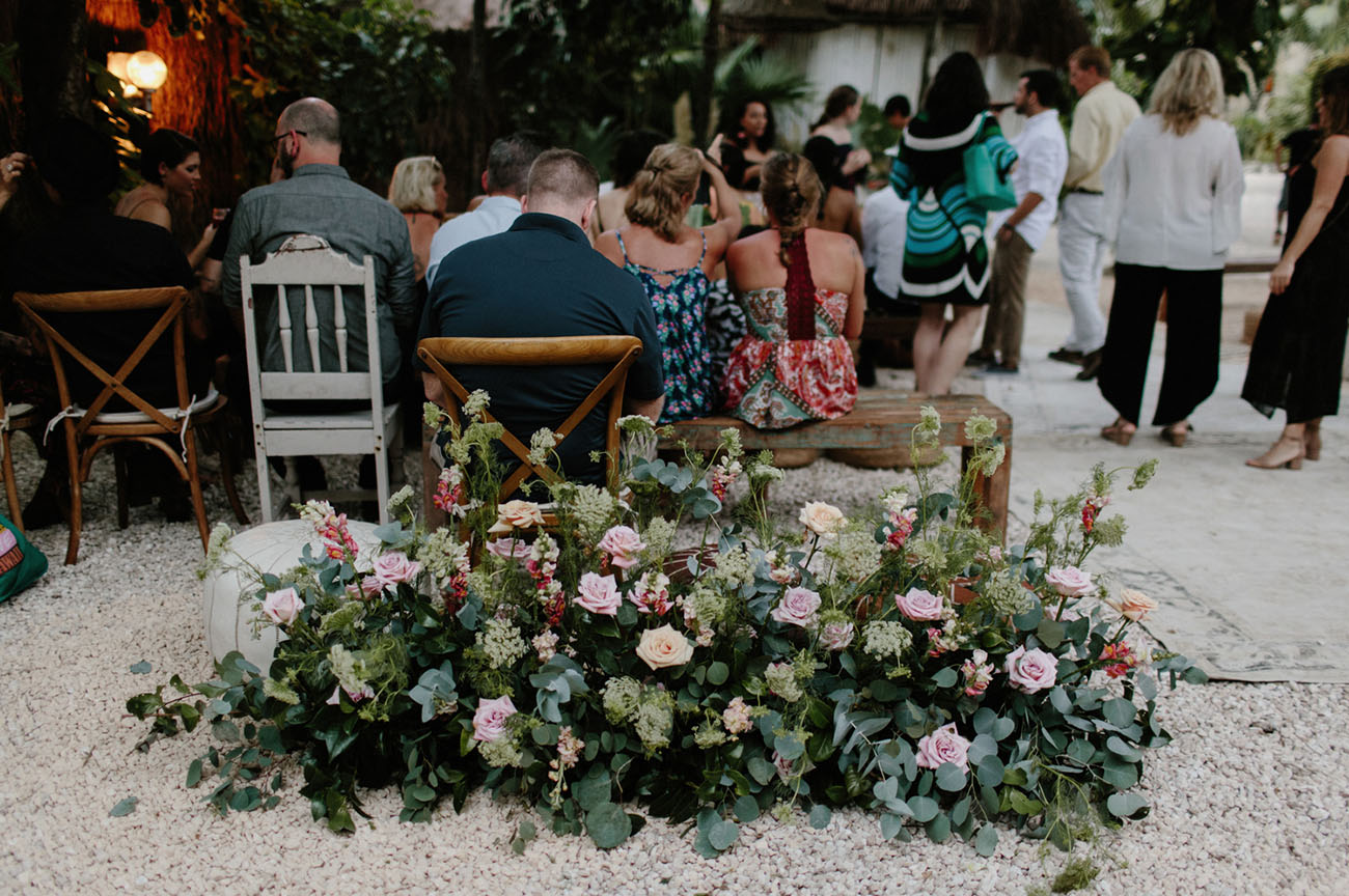 Lush florals with pink roses and much greenery were created for every space of the wedding