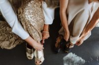 05 One girl chose black heels and the second chose gold mules