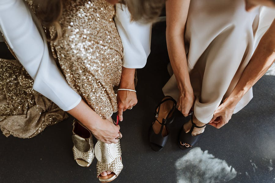 One girl chose black heels and the second chose gold mules