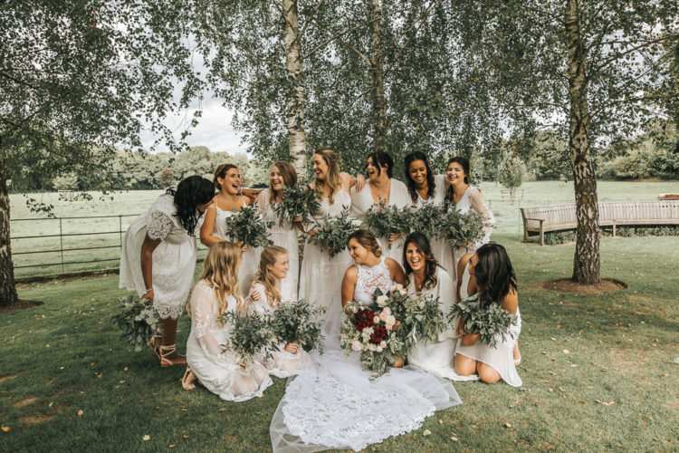 The bridesmaids were rocking mismatching lace dresses, white bridal parties are very popular