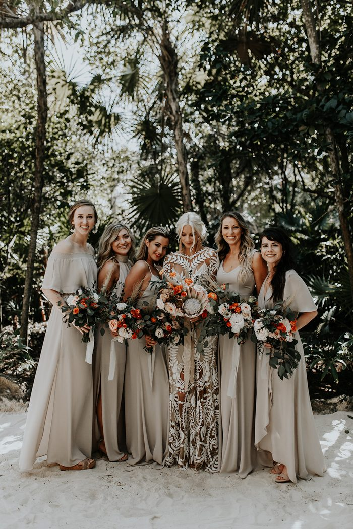 The bridesmaids were wearing off-white mismatching dresses