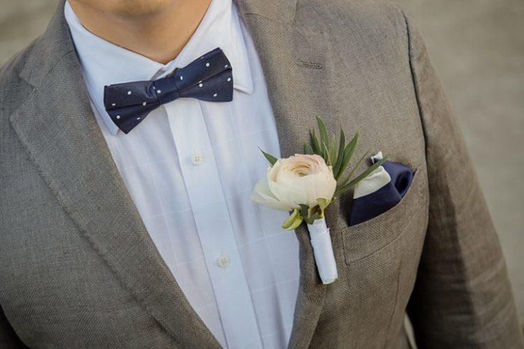 The groom chose a grey jacket, a navy polka dot bow tie and matching boots plus rust pants