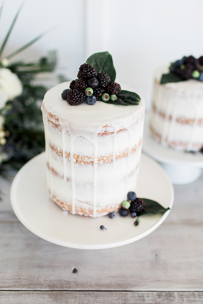The wedding cakes were naked ones with a cream drip, topped with berries and leaves