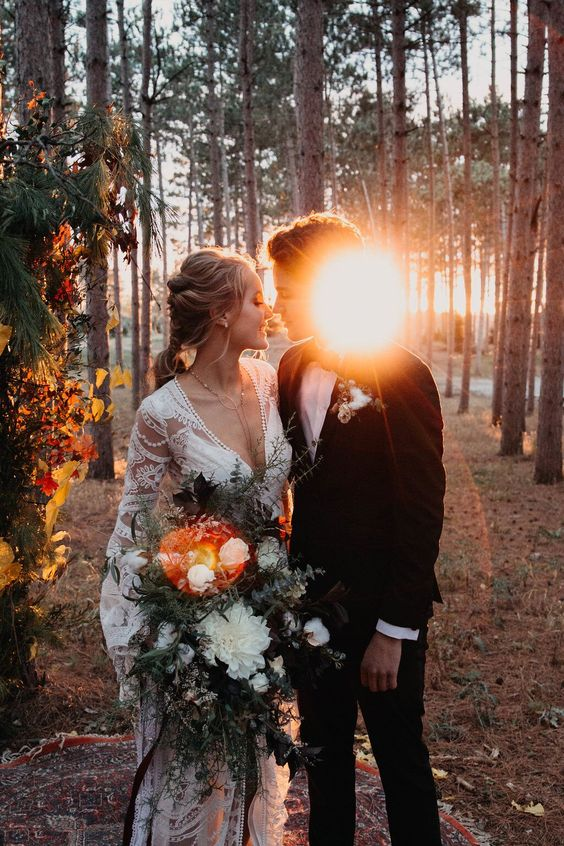 a boho fall couple in the woodlands at the sunset, a wonderful idea for a wedding portrait