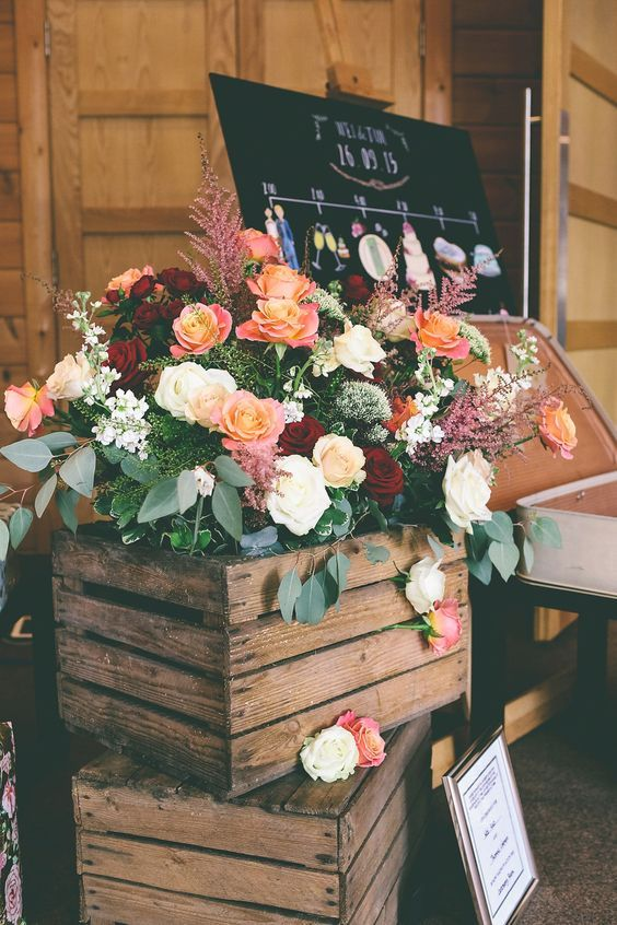 a crate stack with lush florals and greenery to decorate your wedding ceremony space
