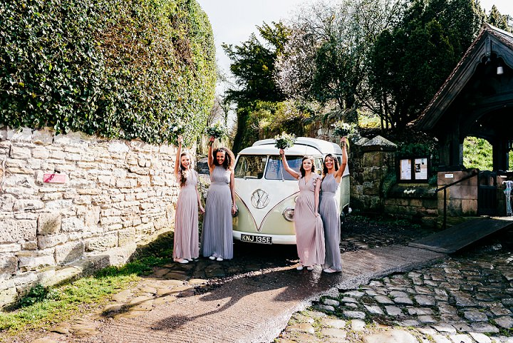 The bridesmaids were wearing pink and lavender maxi  dresses with V and halter neckline