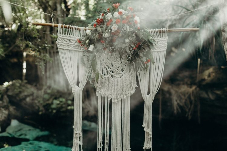 The decor was done with macrame hangings, lush white and red blooms plus textural greenery