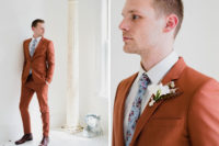 06 The groom was rocking a rust-colored suit, a blue floral tie and brown shoes