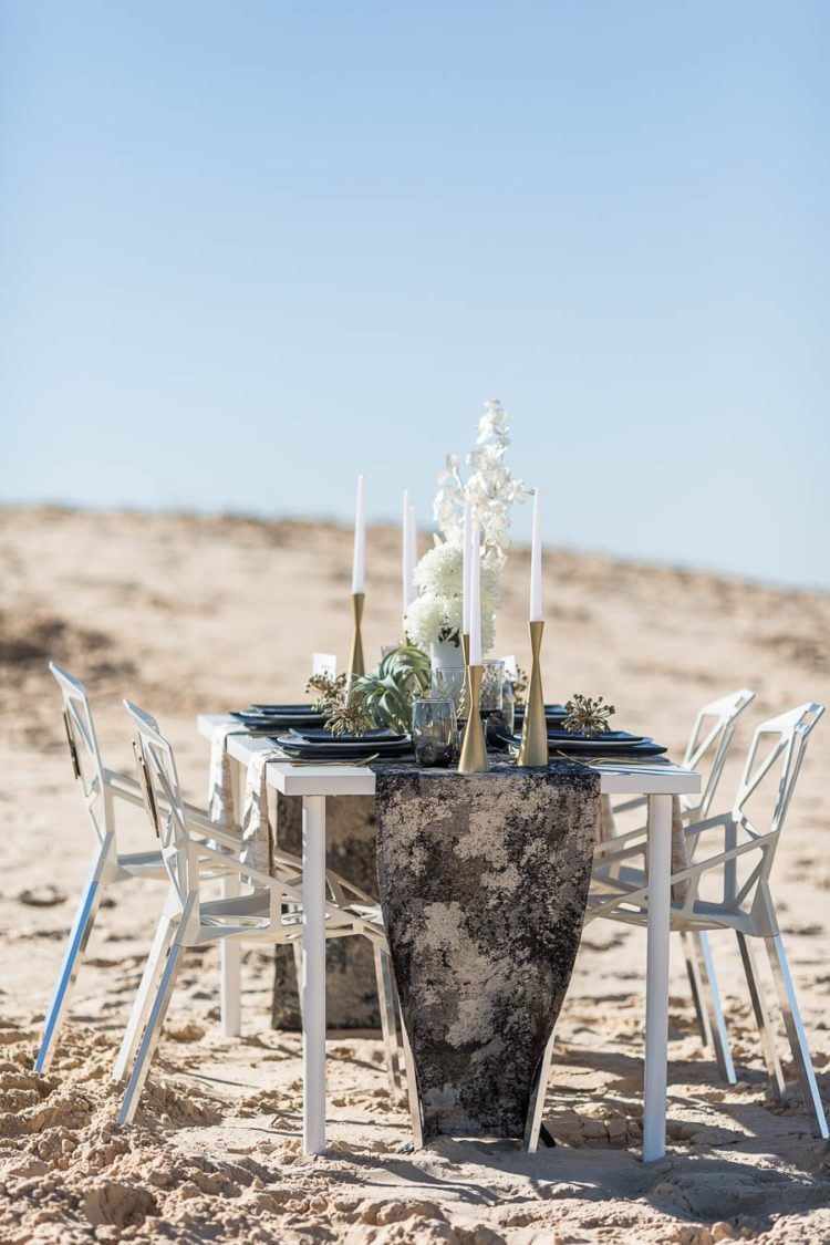 The table was decorated with a black and gold runner
