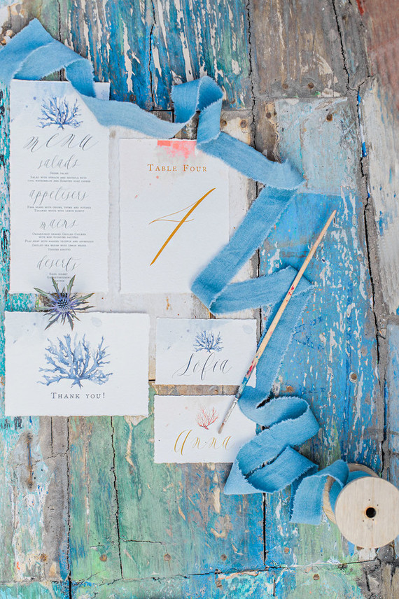 The wedding stationery suite was done with blue watercolors and sea creatures