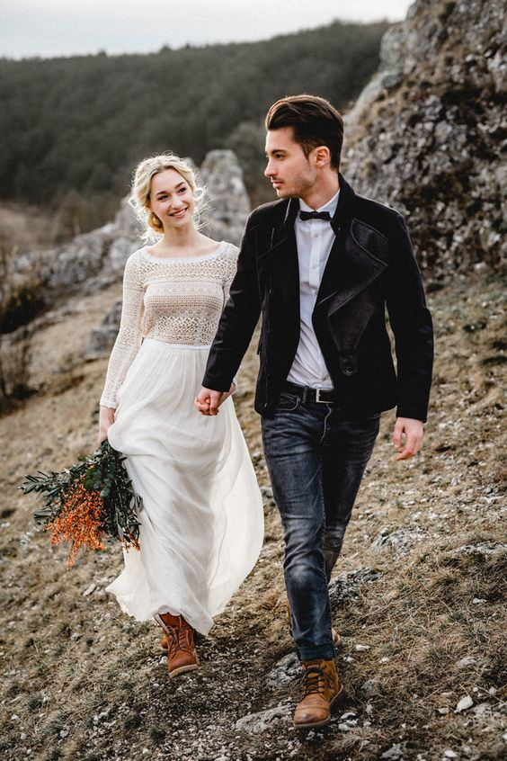a boho-inspired wedding dress with a scoop neckline, a boho lace bodice and a flowy skirt, brown leather boots