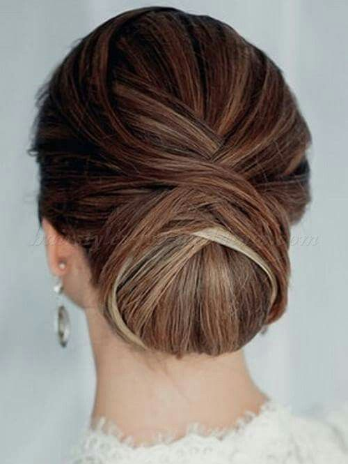 a low twisted very tight chignon guarantees a picture perfect look for the whole day