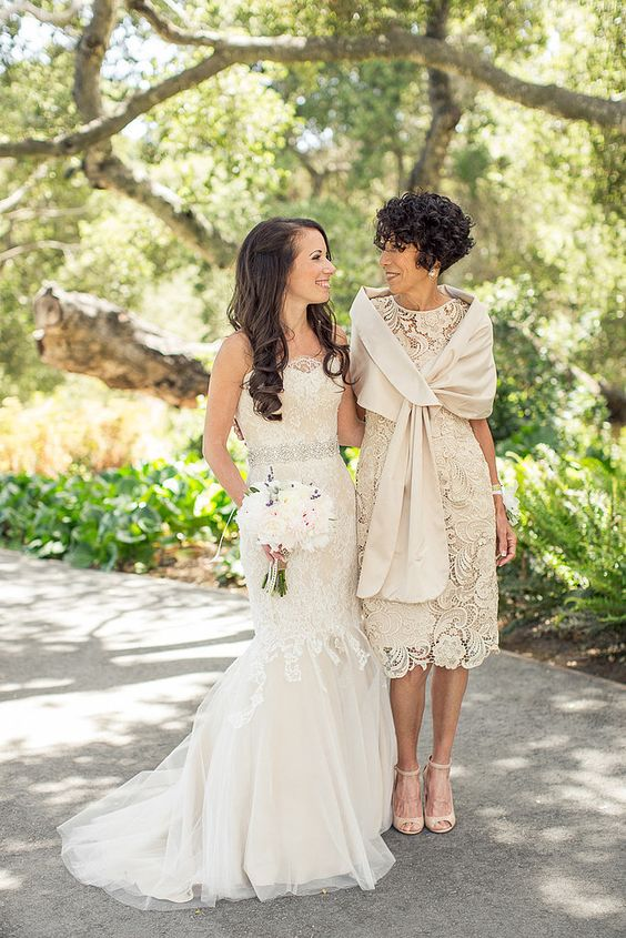 a neutral lace midi length dress, a coverup and ankle strap shoes for the mother of the bride