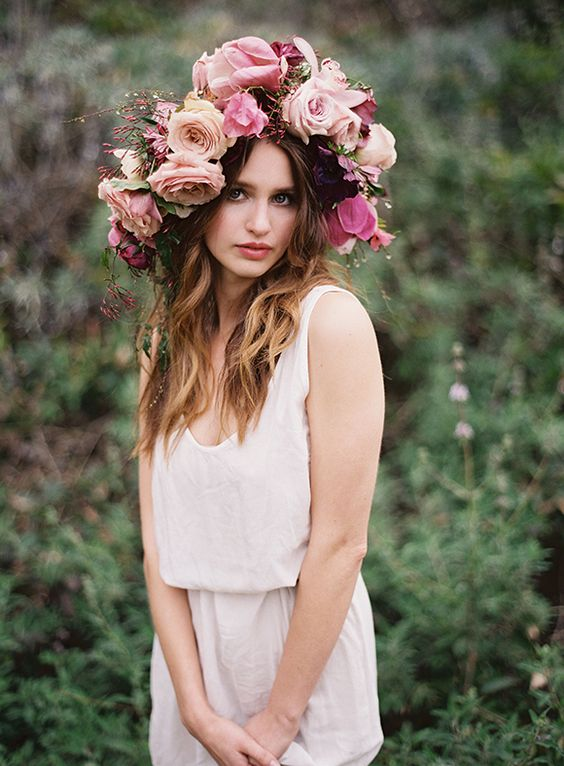 oversized tropical floral crown in the shades of pink, with roses and orchids for a tropical bride