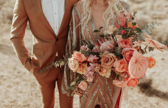 The bridal bouquet was a large textural one, with orange and peachy blooms plus eucalyptus and ribbons