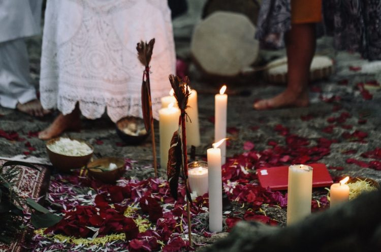 The decor was also done with petals, candles and feathers plus rugs for a boho feel