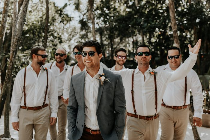 The groomsmen were dressed in white shirts, tan pants, brown suspenders not to feel hot