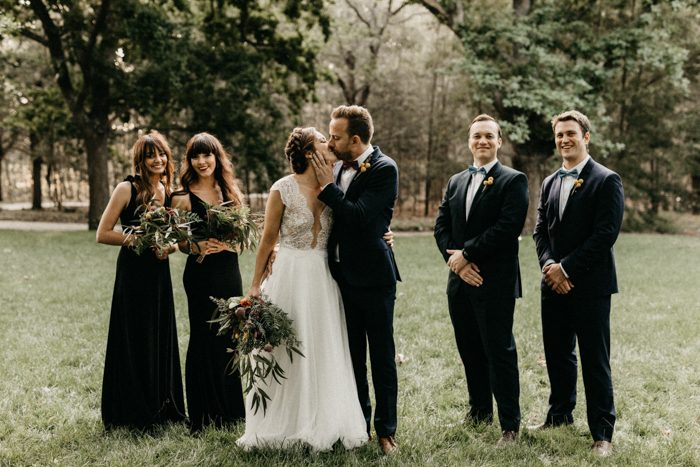 The groomsmen were wearing tuxedos, the bridesmaids were rocking elegant black maxi dresses