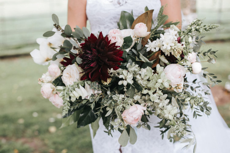 The wedding bouquet was done with pink peonies, dahlias and much greenery
