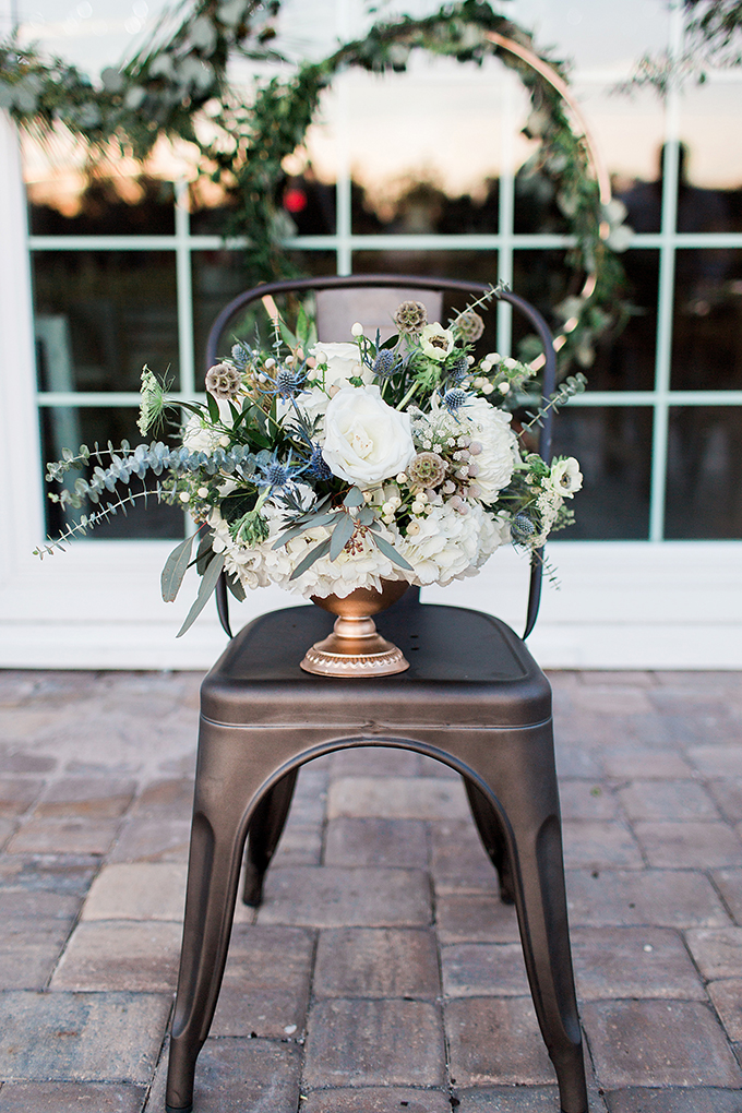 The wedding florals were done with much textural greenery, white blooms and blue thistles