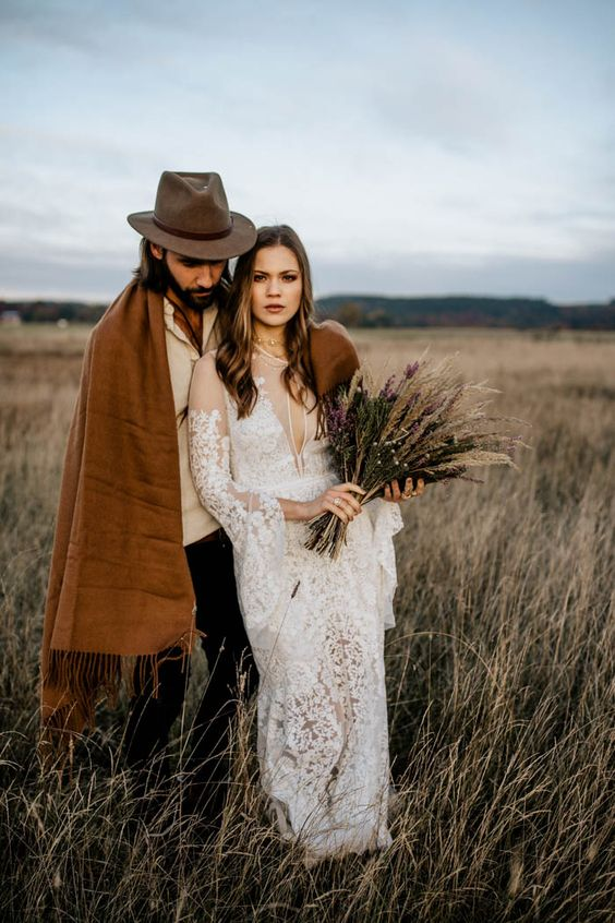 a boho fall couple, a hat and a blanket, a herb wedding bouquet
