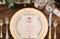 07 a chic and stylish table setting in burgundy and gold with greenery and chic blooms