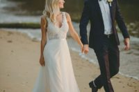 07 a chic gown with a lace sleeveless bodice with a V-neckline and a pleated layered skirt