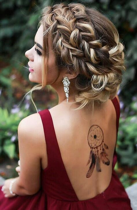 a double fishtail braided updo with some locks down looks very sexy and bold