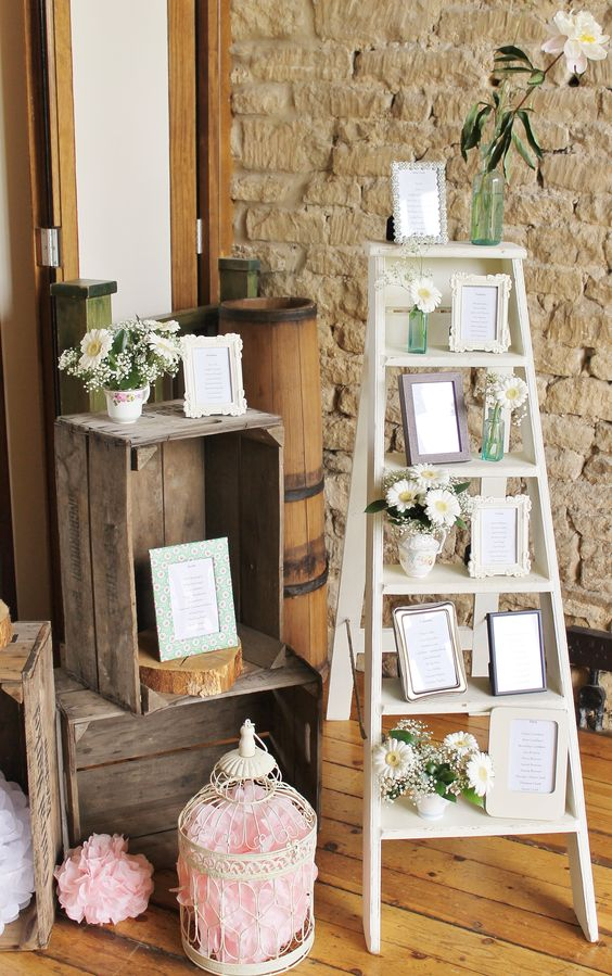 a ladder with favorite framed quotes and blooms in jars and vases for a vintage wedding