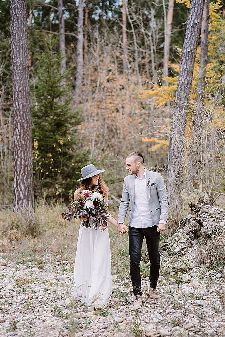 black jeans, a white shirt, a grey blazer and a trendy hairstyle for a woodland elopement