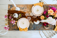 08 The shabby chic table was done with a rust table runner, mustard napkins, gold cutlery and bright and lush blooms
