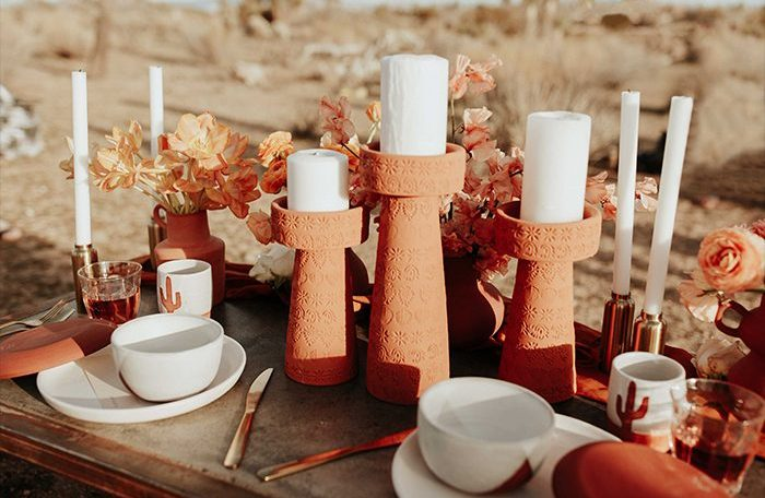 The wedding picnic table was style with a lot of terra cotta, orange and peachy blooms and leaves