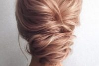 08 a French twist low updo with a messy look and texture for an elegant yet effortless look