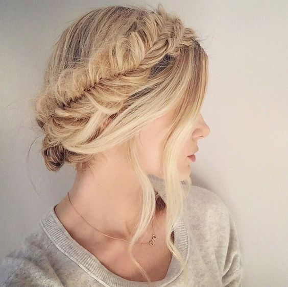 a fishtail braid halo updo with locks down is ideal for a boho bride and looks unique