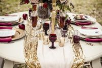 08 a gorgeous table setting with a gold sequin table runner and burgundy touches plus candles for a wow effect