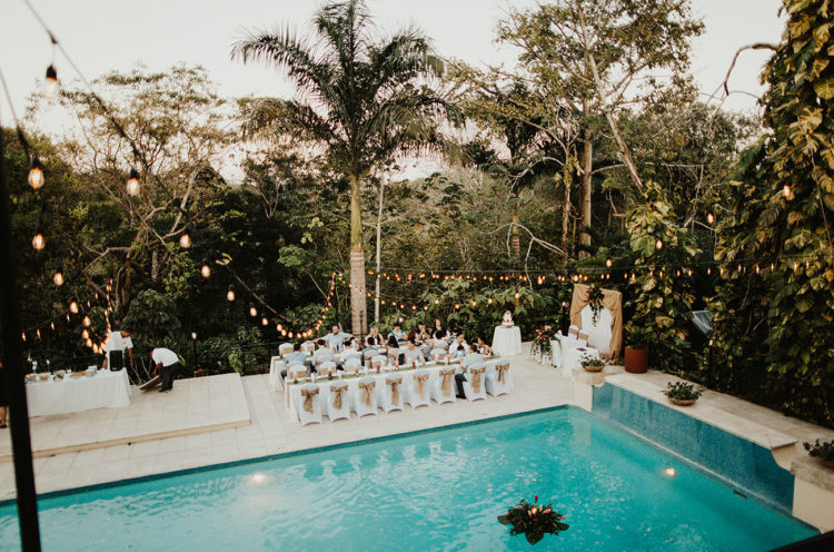 The reception took place at a resort, by the pool to let the guests relax after the adventure