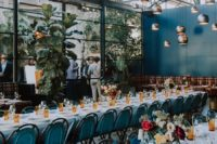 09 The wedding venue was industrial, with touches of blue and teal and amber glasses plus cute blooms