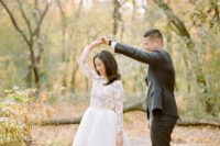 09 a chic wedding dress with lace appliques on the bodice and a plain skirt plus black suede shoes