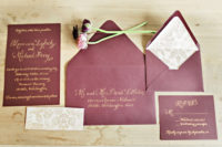 09 a chic wedding invitation suite in burgundy and with gold calligraphy and botanical prints